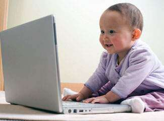 Baby Playing with Computer