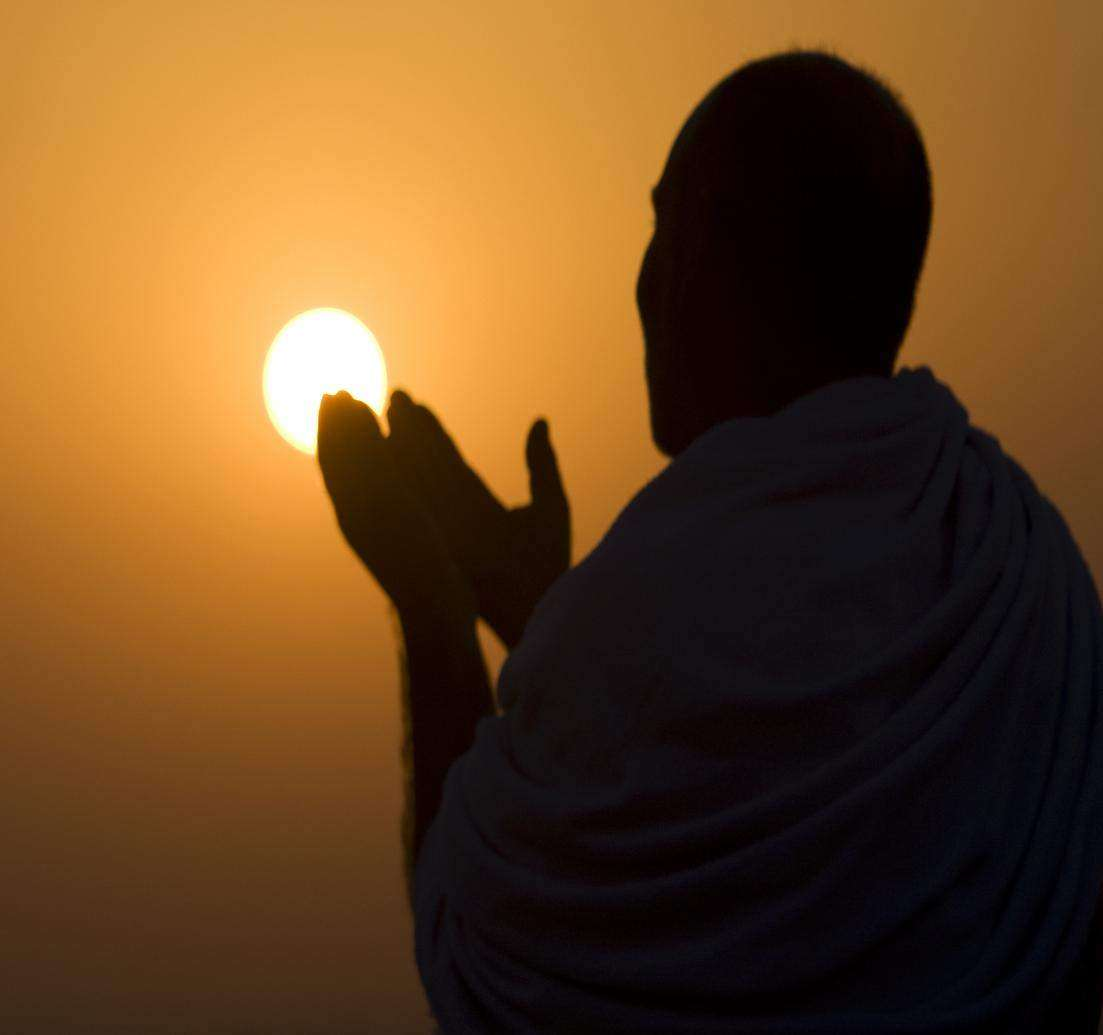 A Muslim pilgrim prays at the top of Mount Noor in Mecca